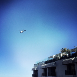 Police chopper circling the rooftop pool
