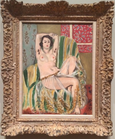 Henri Matisse, 1869-1954. Oxalis qui, Seated with Arms Raised, Green Striped Chair, 1923.