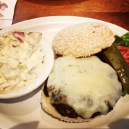 Cheese Burger, potato salad, and a giant pickle